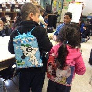 GivingWorks NYC kids with new backpacks