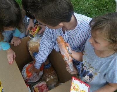 Hungry children receiving food in Burton, Michigan