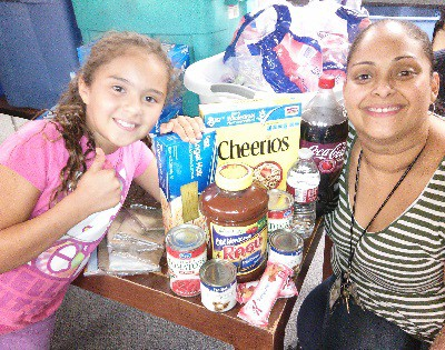 Child receives donated food in Whitney, Nevada
