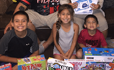 low income kids in Florida with holiday gifts sent by sponsor
