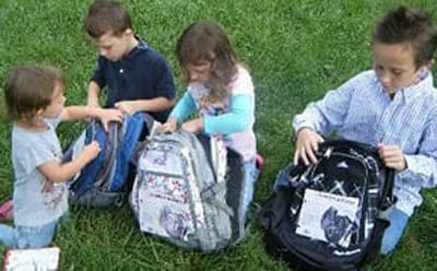 low income kids in Burton, MI with donated backpacks and school supplies