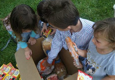 Burton, MI kids opening donated box of food