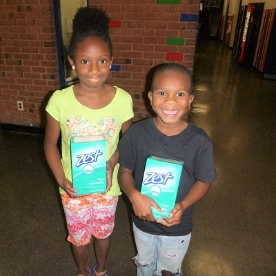 kids with donated soap