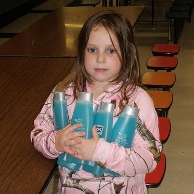 child with donated shampoo